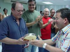 Here, troubadour Silvio Rodríguez received a copy of the Shield in Camagüey, Cuba.