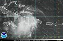 Tropical Storm Fay spun toward Cuba on Sunday after lashing Haiti and the Dominican Republic