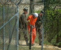 In Guantanamo Cuba: Torture to one, interrogation to another
